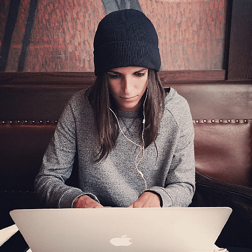 Woman writing at laptop